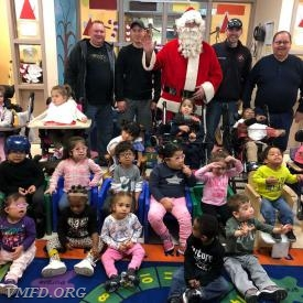 Santa Claus & his Elf's with the Pre-K class